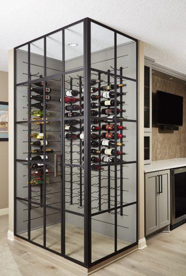 Floor to ceiling black framed glass wine cellar. Wine racks, Wine Room. Basement wine cellar.