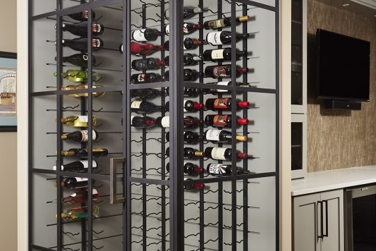 Floor to ceiling black framed glass wine cellar. Wine racks, Wine Room. Basement wine cellar.