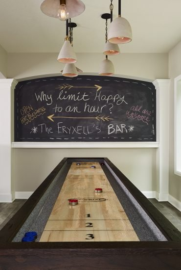 A chalkboard transforms a blank wall into an interactive space – perfect for tallying game scores, listing drink menus, and drawing welcome signs