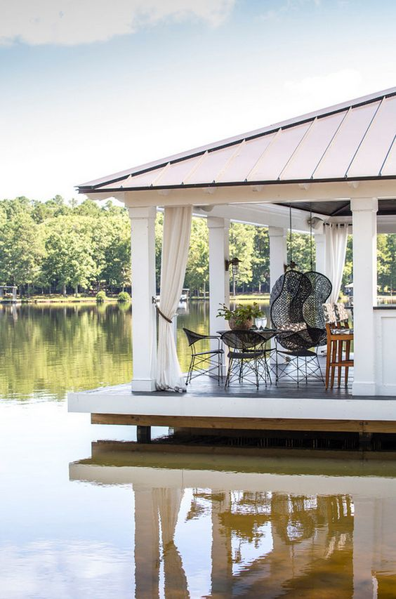 A bright white boathouse doubles as the ultimate relaxation station