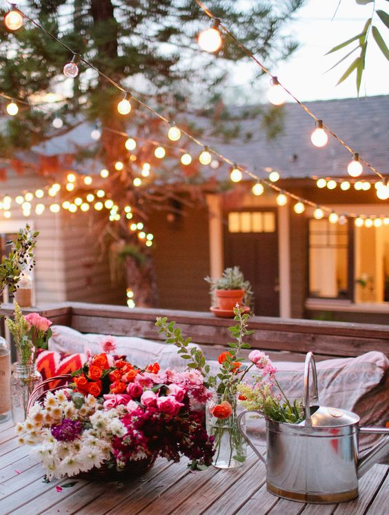 Café lights brighten up this beautiful backyard in the early evening
