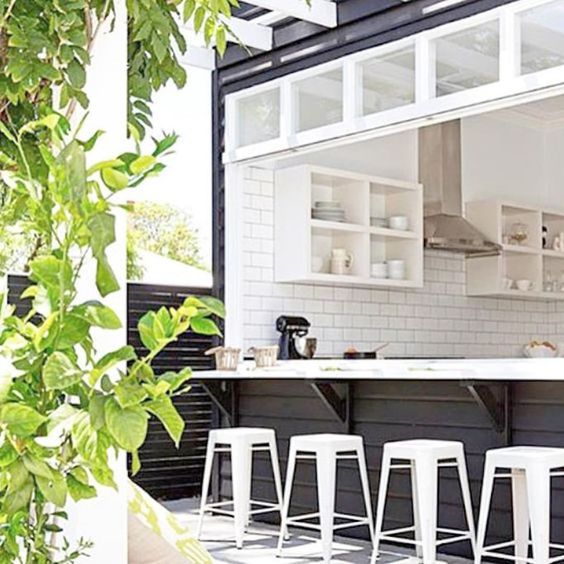 A chic black and white bar is a great backyard addition