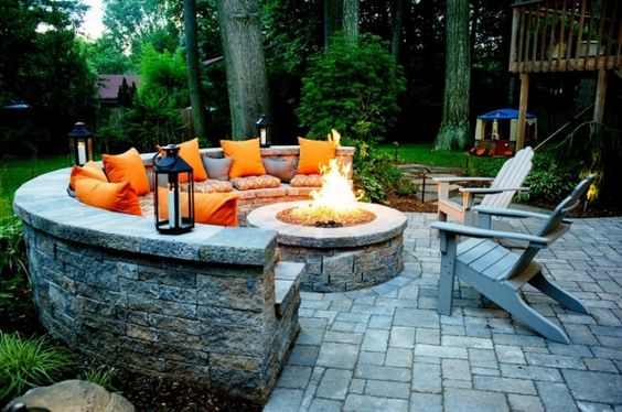 Built-in lounge seating and a fire pit make this the perfect entertaining space