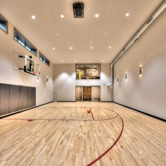 A brightly-lit sport court is the ultimate workout space in this home