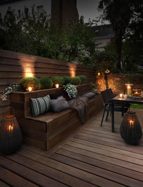 Lanterns and candle lights add a soft glow to this patio