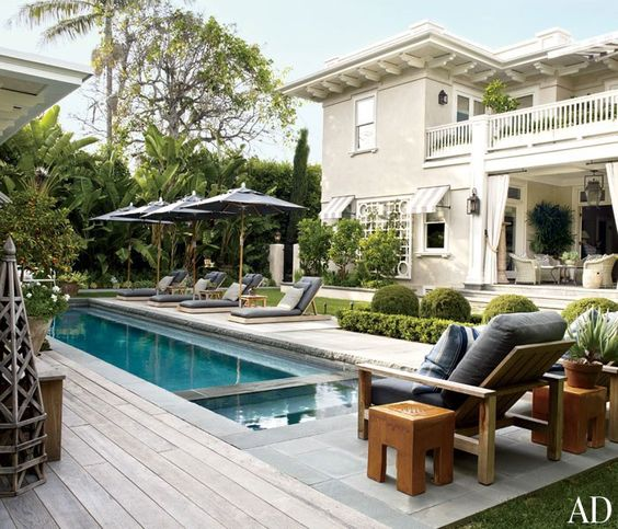 Sleek black umbrellas offer shade for poolside guests