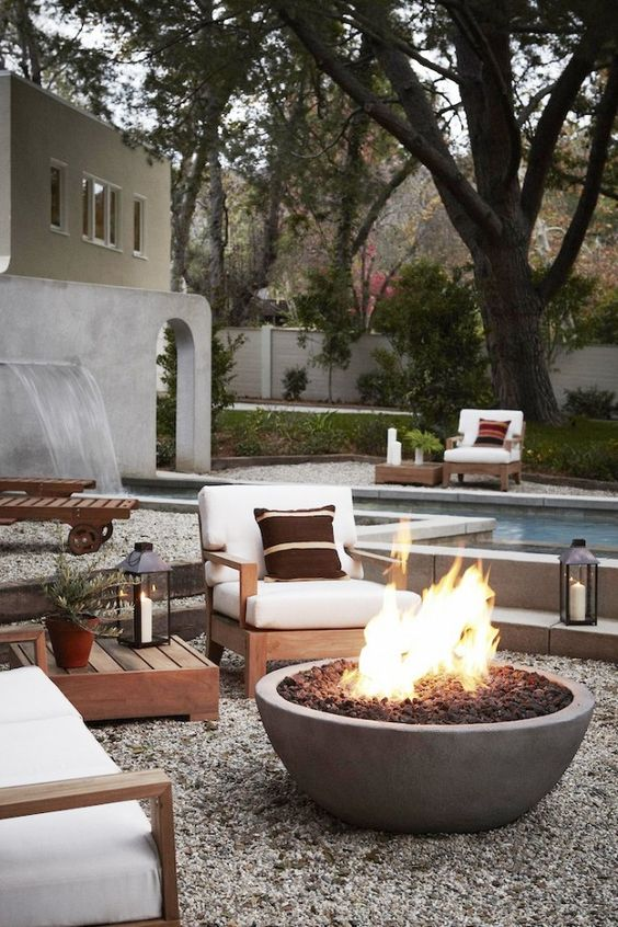 A sleek fire pit is paired with a neutral patio space for a modern feel