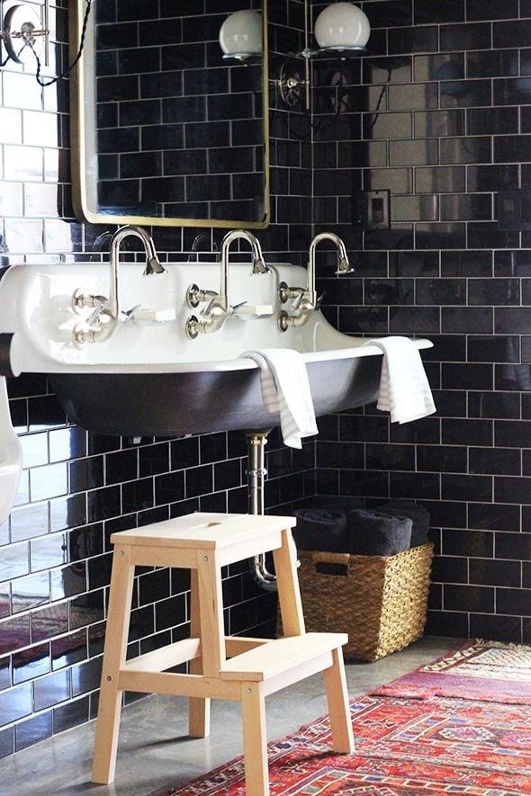 Black subway tiled wall in bathroom