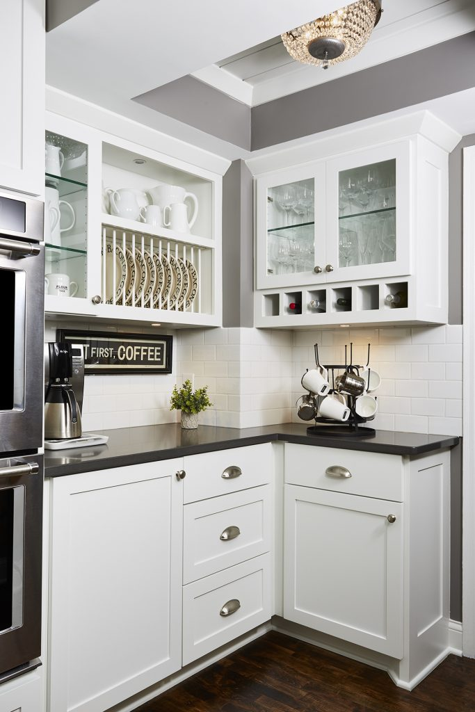 White subway tile backsplash with white grout in kitchen