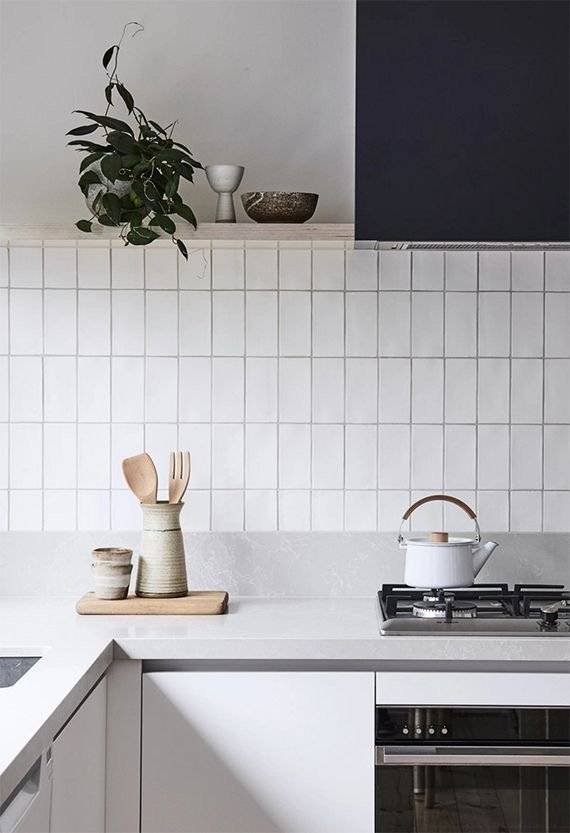 Kitchen backsplash with vertically-arranged white Catalina subway tiles