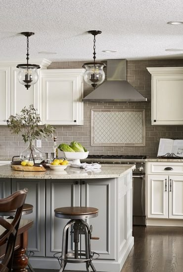 Bright new creamy white custom kitchen. Soft grey center island with curved graite top maximizes seating.