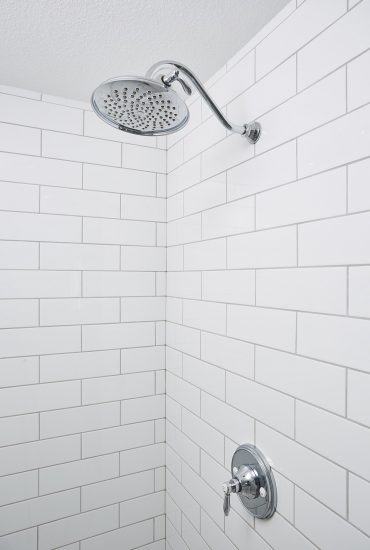 Long white subway tile, chrome fixtures