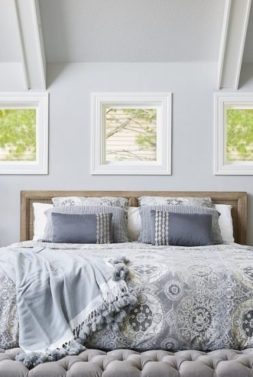 Master bedroom in hues of blue, grey and creamy whites.