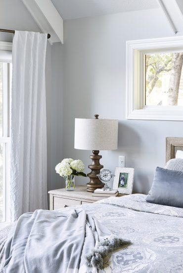 Cozy corner of the bedroom in soft blues, white and cream.