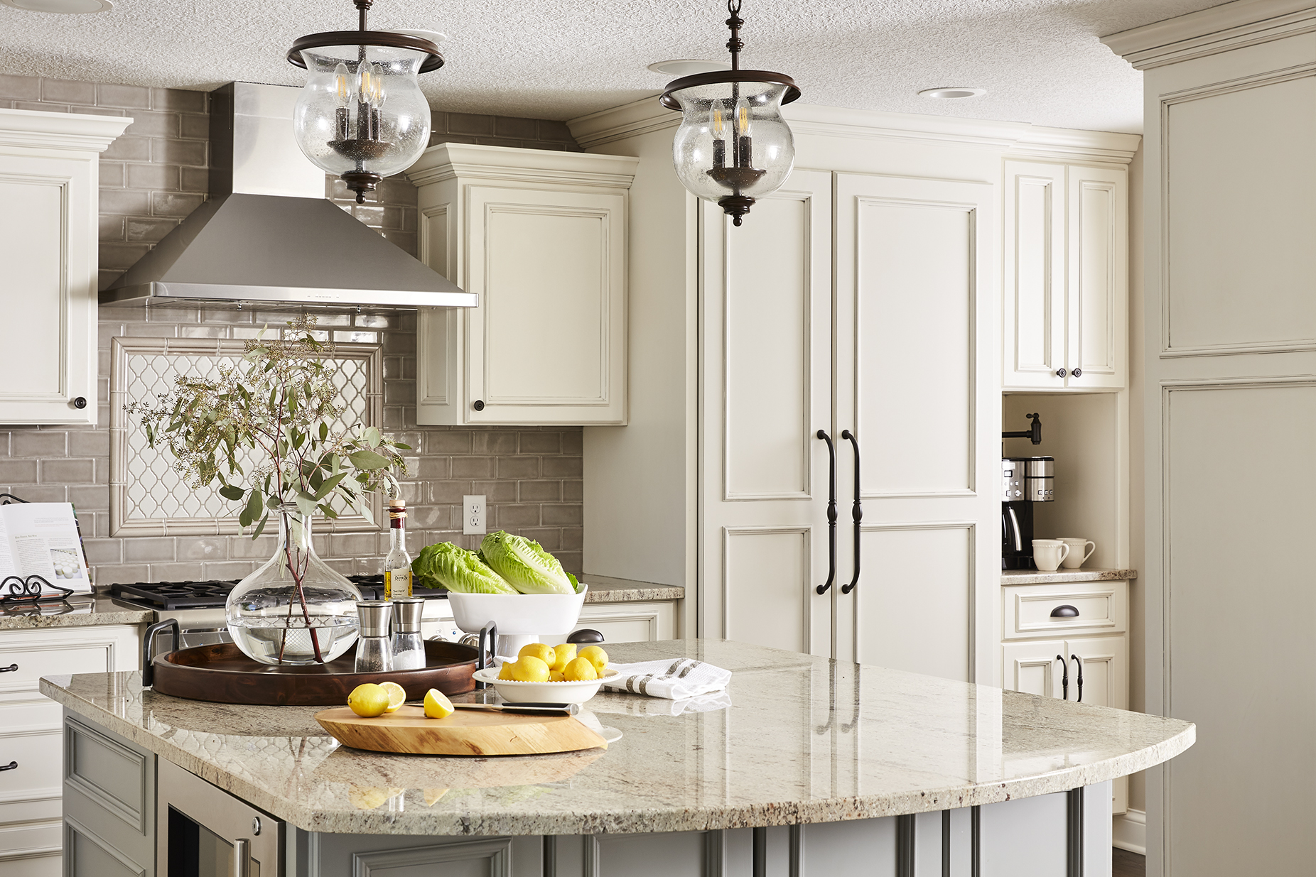 Granite countertops provide a classic element to this kitchen, giving ample space for cooking and entertaining.