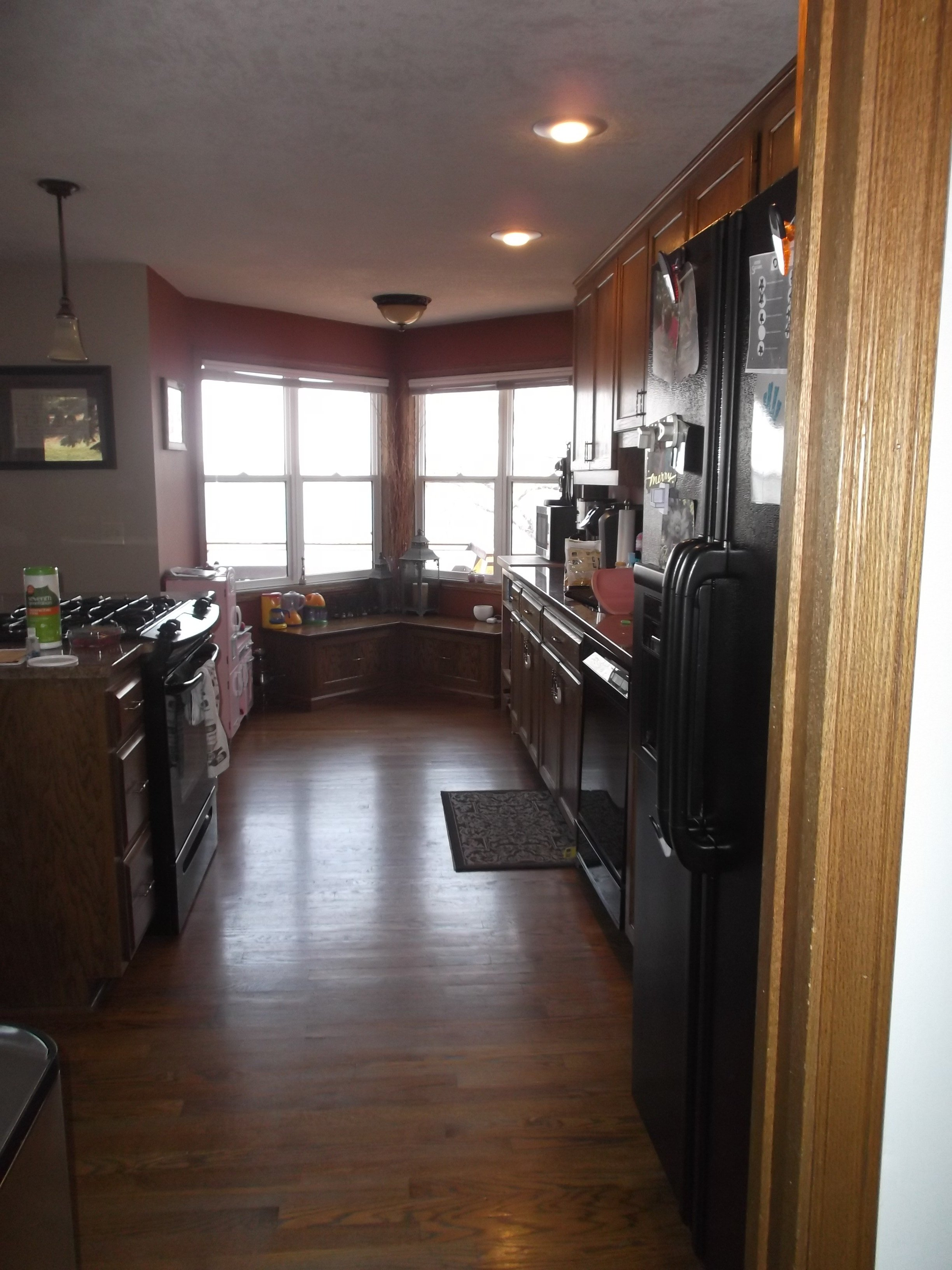 The darker earth tones in this kitchen made the space feel dark despite the large windows.