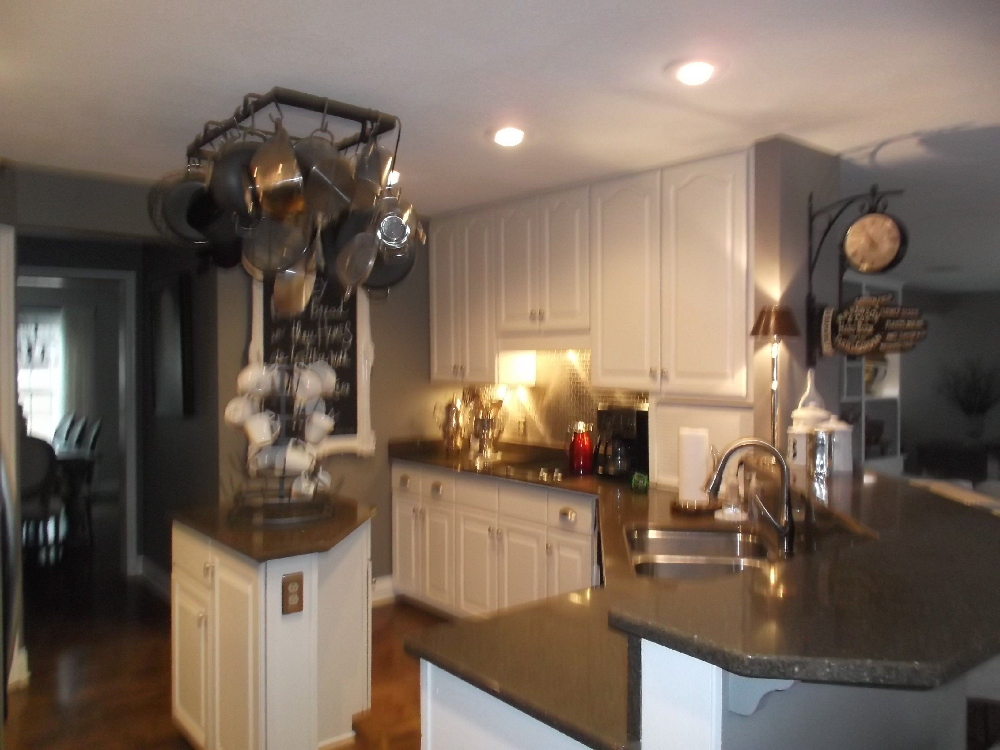 The owners of this outdated kitchen wanted to open things up and make the space feel more contemporary overall.