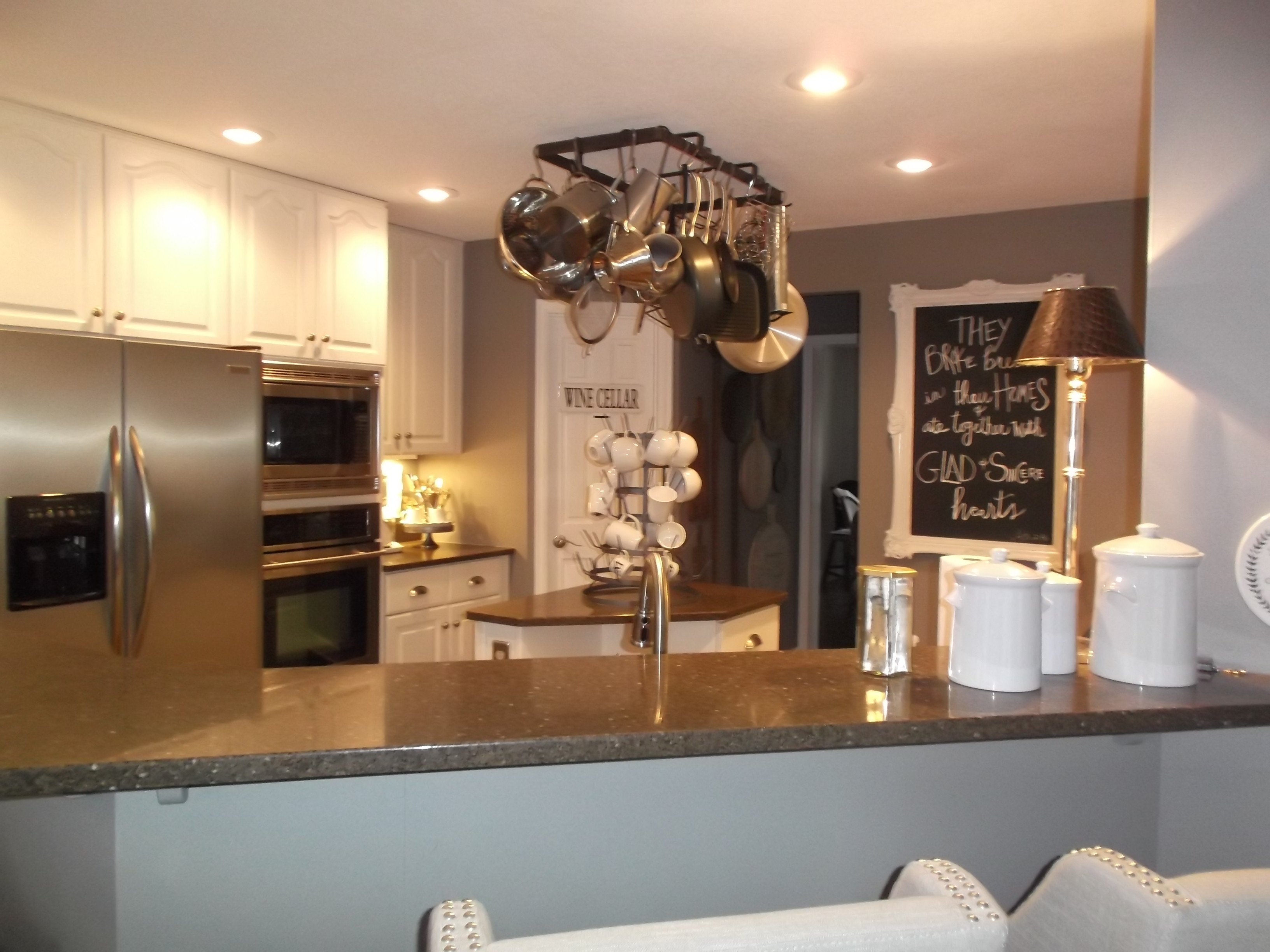A center kitchen island coffee bar took up a lot of floor space in this 1990s-style kitchen.
