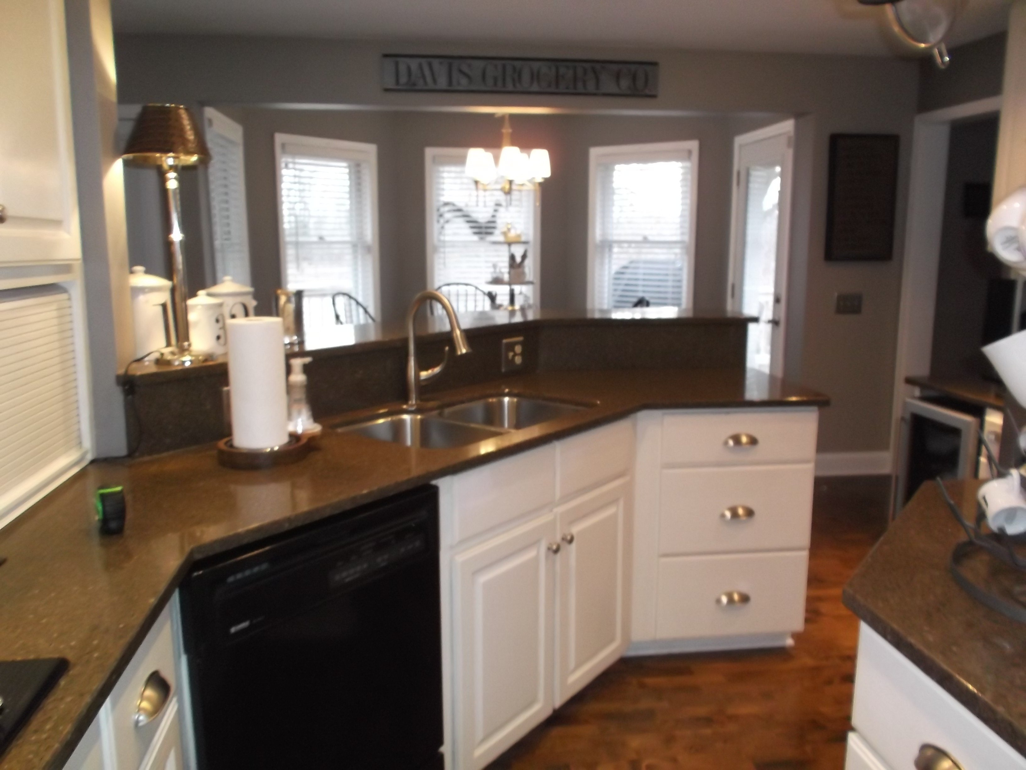 A two-tiered kitchen peninsula made the countertop space feel diminished and blocked the view around the room.