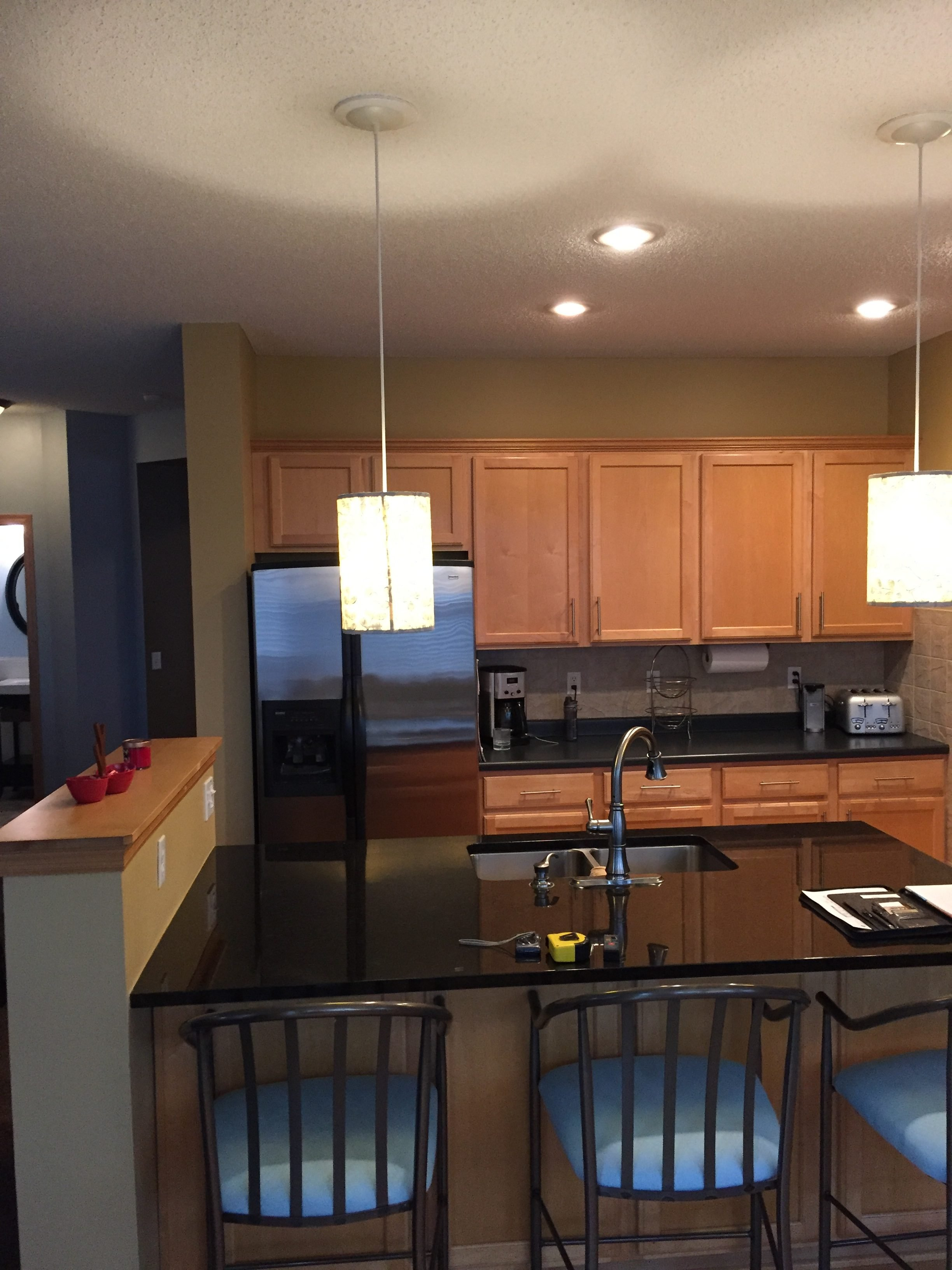Black countertops were a bit too much of a contrast against the warm wood cabinets, and made the space feel much smaller than it was.