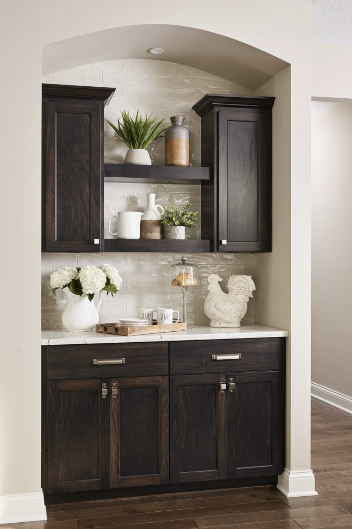 A coffee bar offered an extra storage nook in this kitchen, using wall space strategically and functionally.