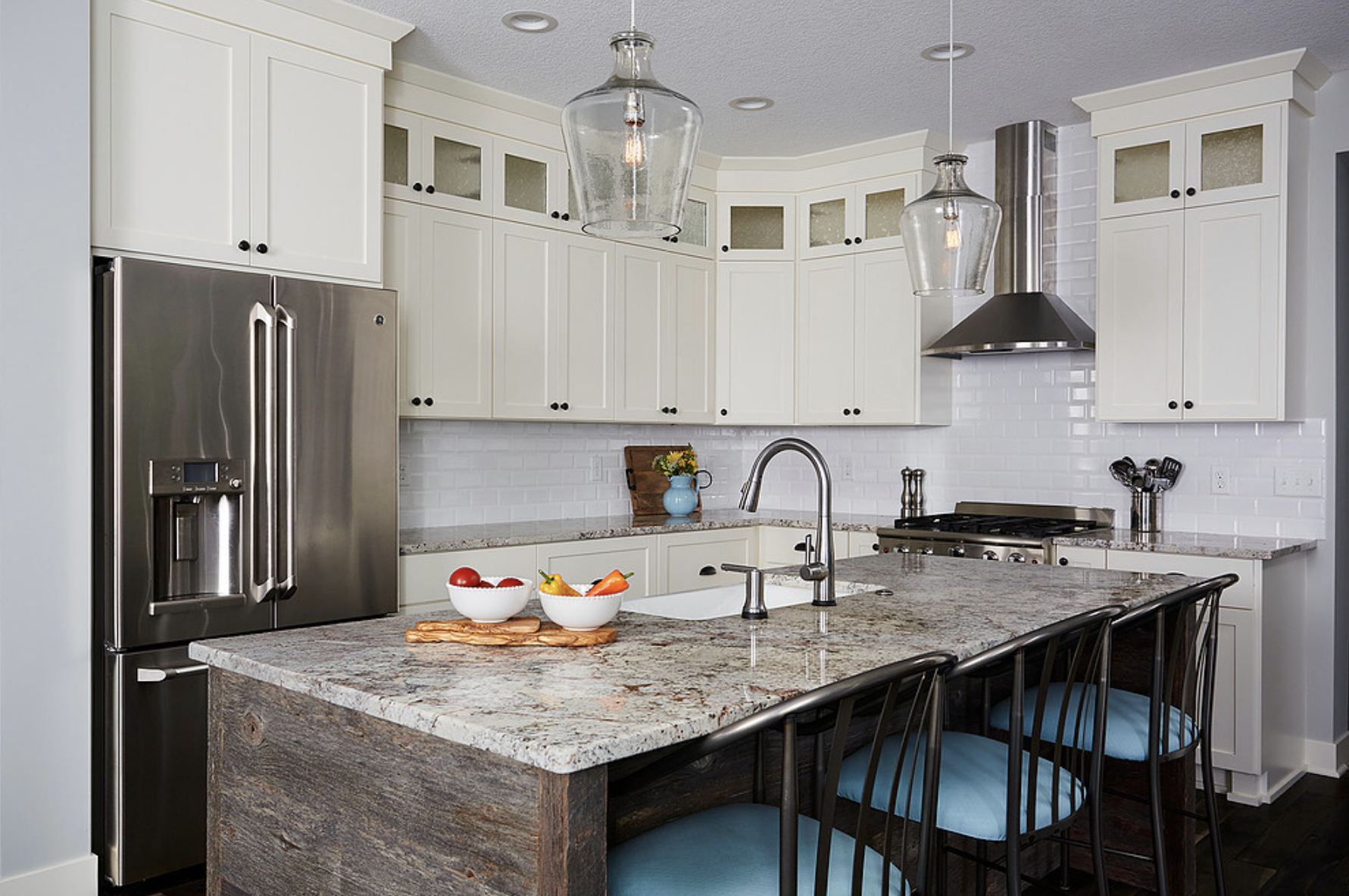 Warm white cabinets paired with bright white subway tile instantly made this remodeled kitchen feel lighter and more open.