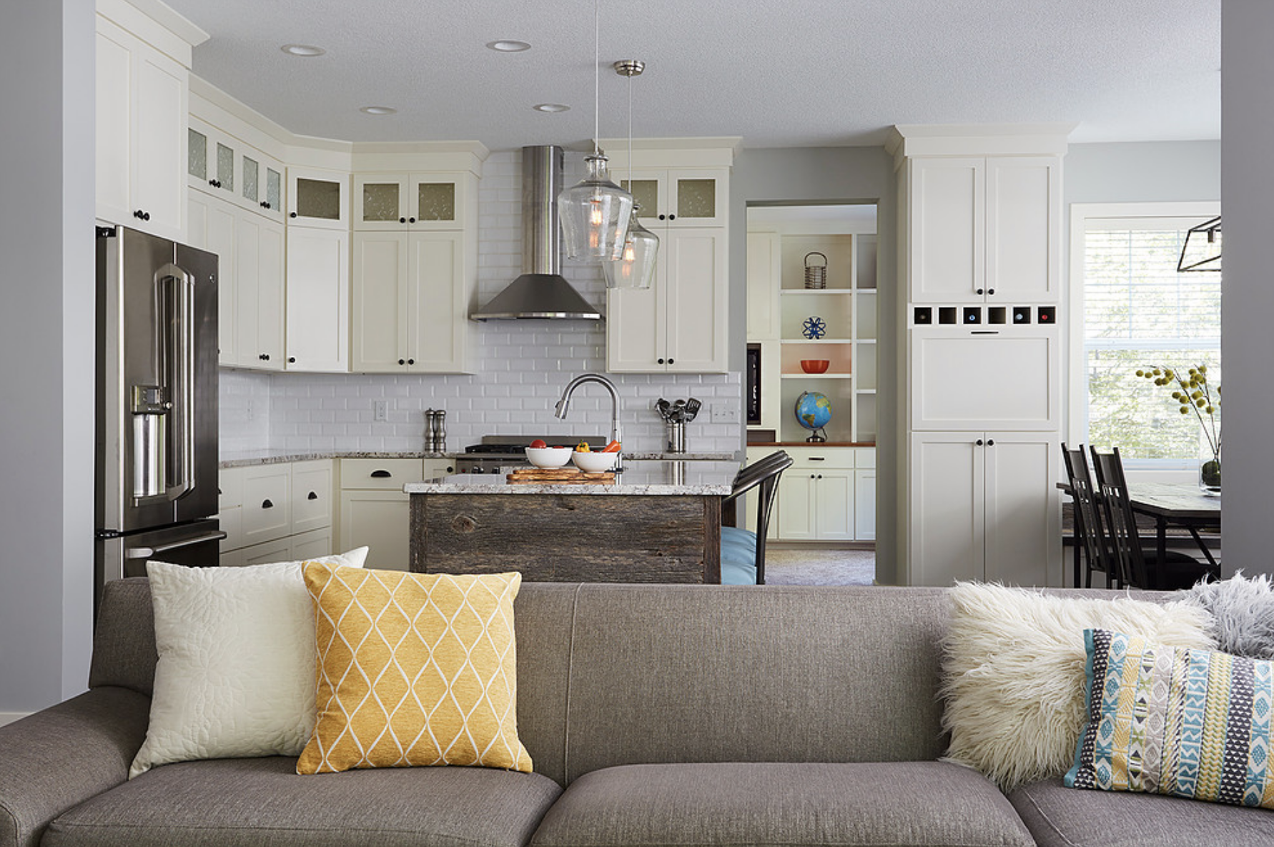 A focus on lighter hues in this newly remodeled kitchen helped the already-open layout feel even more welcoming and spacious.