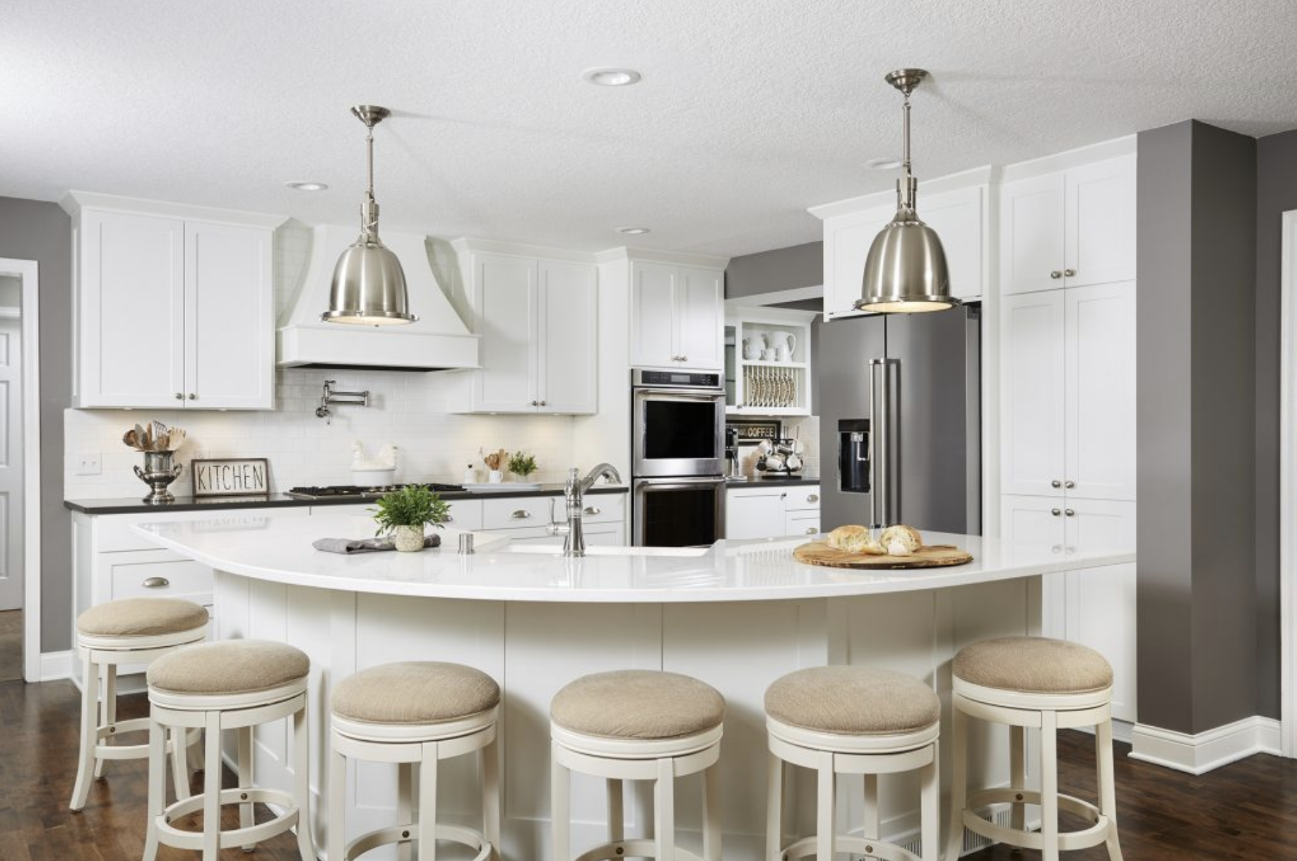 A new rounded kitchen island with ample seating gave this kitchen a contemporary and open vibe.