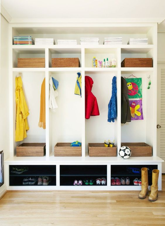 This mudroom offers excellent storage solutions for kids, including individual cubby spots with hooks for coats, wall space to hang artwork, baskets to collect sports gear, and dedicated areas for shoes. / Source