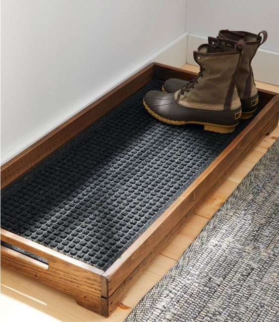 A simple boot tray serves as both a storage area for shoes and an easy-to-clean collection station for water and dirt. / Source