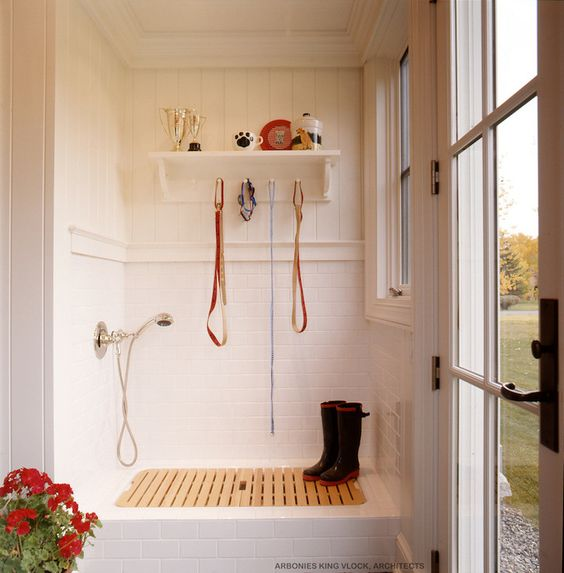 Right next to the door, this mudroom's shower is the perfect place to clean off mud, helping to avoid tracking messy footprints through the house. / Source