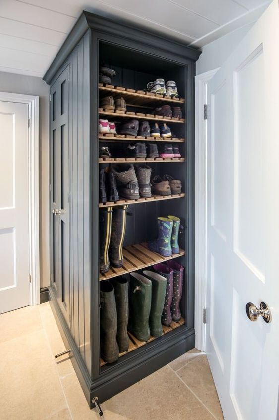 Shelves with slats offer plenty of shoe storage for the entire family, while also allowing boots to dry when wet. / Source