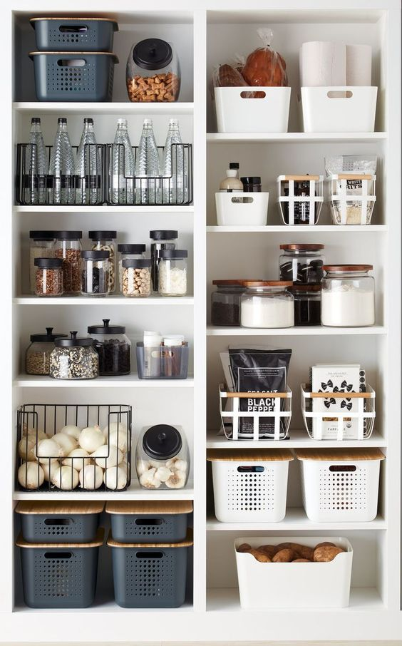 Black, grey, and white serve as a chic color palette for this pantry, making it visually beautiful while also providing convenient areas for storage.
