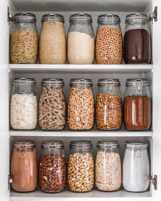 Identical glass containers give this pantry a beautiful and crisp aesthetic while also allowing for easy identification of cooking essentials.