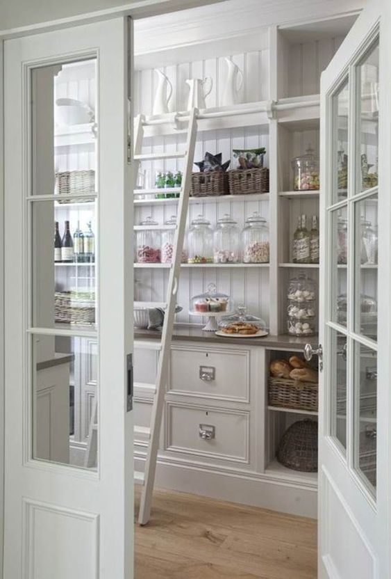 In this stunning butler's pantry, breakable dishware is kept on the highest shelves, but a sliding ladder still provides easy access when needed.