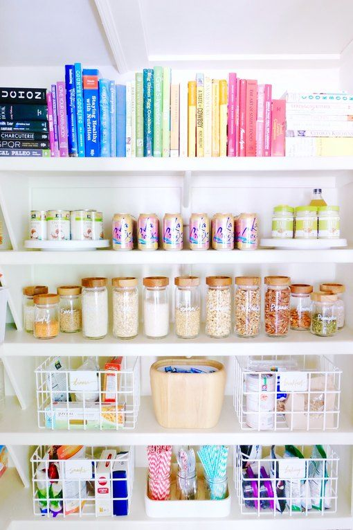 In this pantry, non-essentials like cookbooks are stacked on the top shelf out of the way; bottom shelves are reserved for baskets of snacks and easy-to-grab items for the whole family.