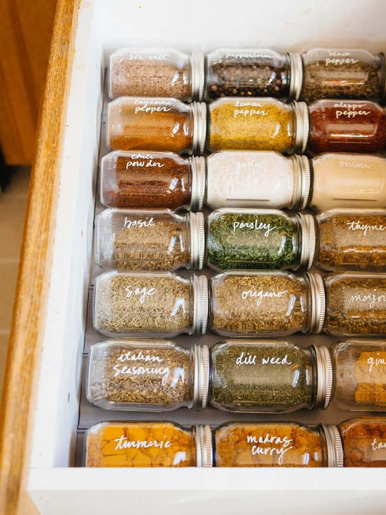 An easy-to-access spice drawer with clearly readable labels makes cooking an enjoyable task.