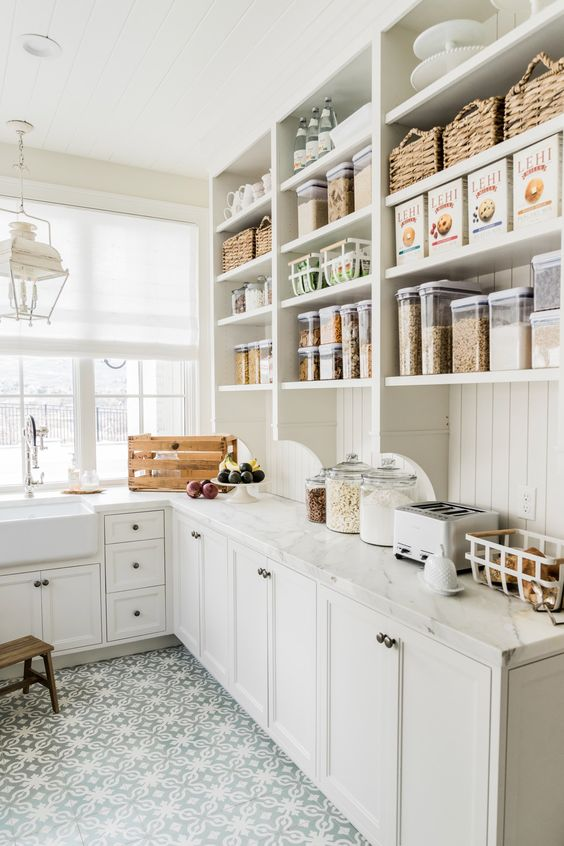 This farmhouse-inspired pantry space incorporates a spacious counter for everything from baking essentials to small appliances that make school morning prep quick and simple.