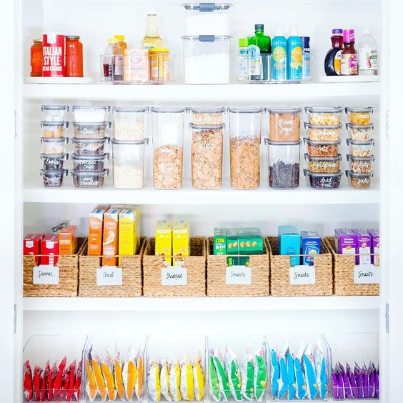 A color-coded pantry is both convenient and visually appealing, and by keeping all the kid-friendly foods on the lowest shelves, it offers the highest level of functionality for the space.