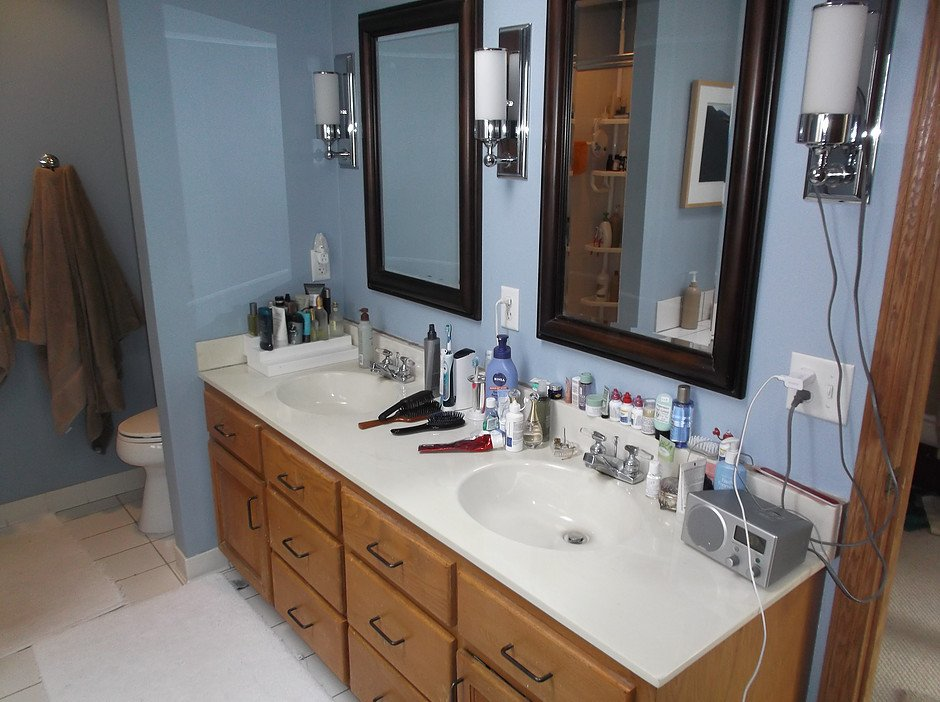 His & hers sinks in this bathroom had a decent amount of counter space, but it all felt cluttered and cramped without proper storage options built in.
