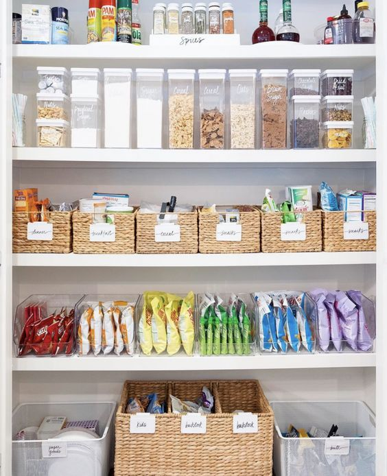 Kid-friendly snacks stay on display on the lowest shelves of this pantry, and by grouping them according to color, it makes the space both accessible and fun.