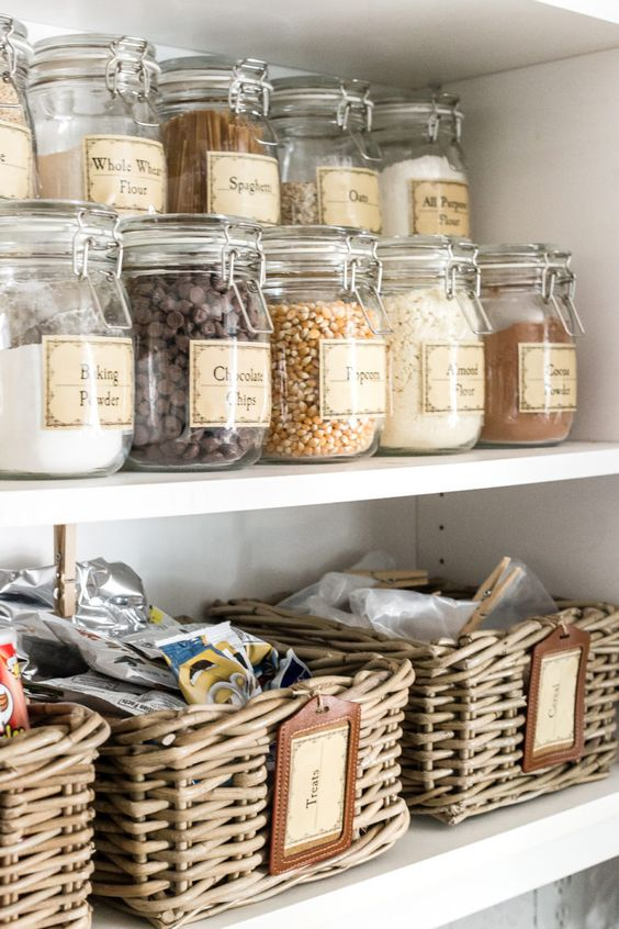 Classic labels for both the clear glass storage containers and storage baskets helps to keep things organized and neat.