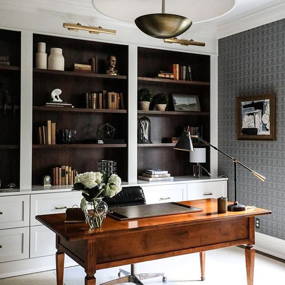 Pairing open shelves and stylish drawers gives this home office a chance to showcase favorite items while keeping clutter tucked safely out of sight. / Source