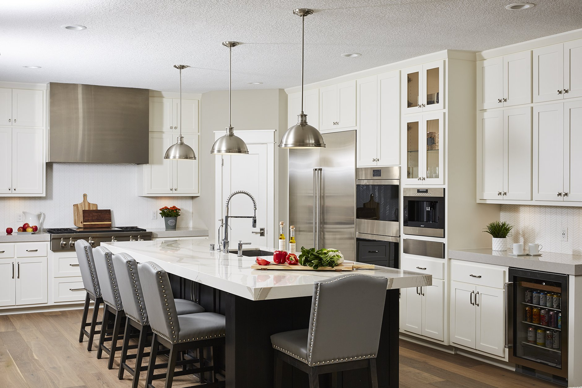 A spacious kitchen island was created to allow for plenty of room for the entire family to socialize, prep food, and eat.