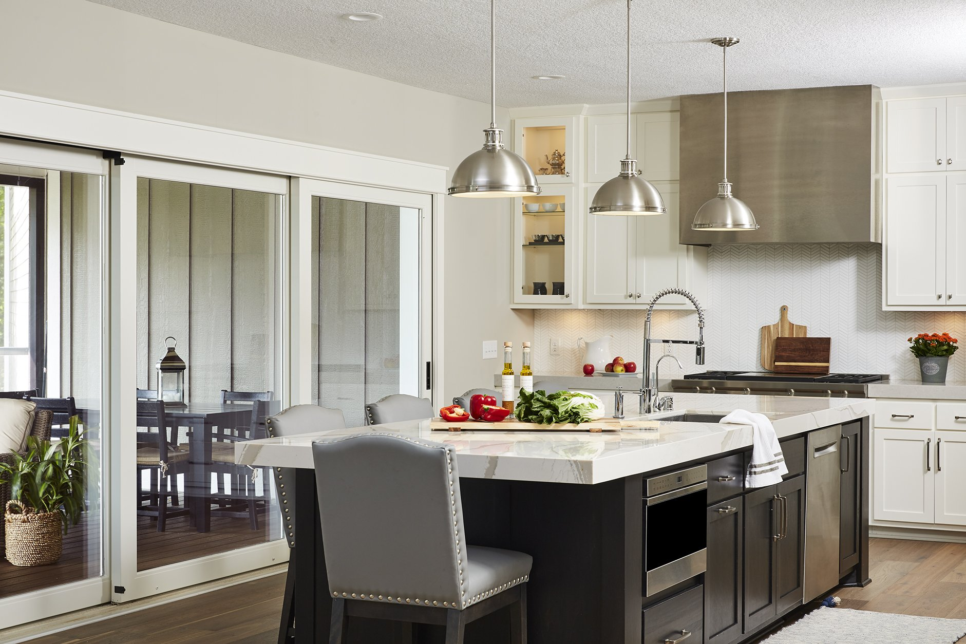 With new sliding glass doors, the kitchen immediately felt more open and accessible to the rest of the home.