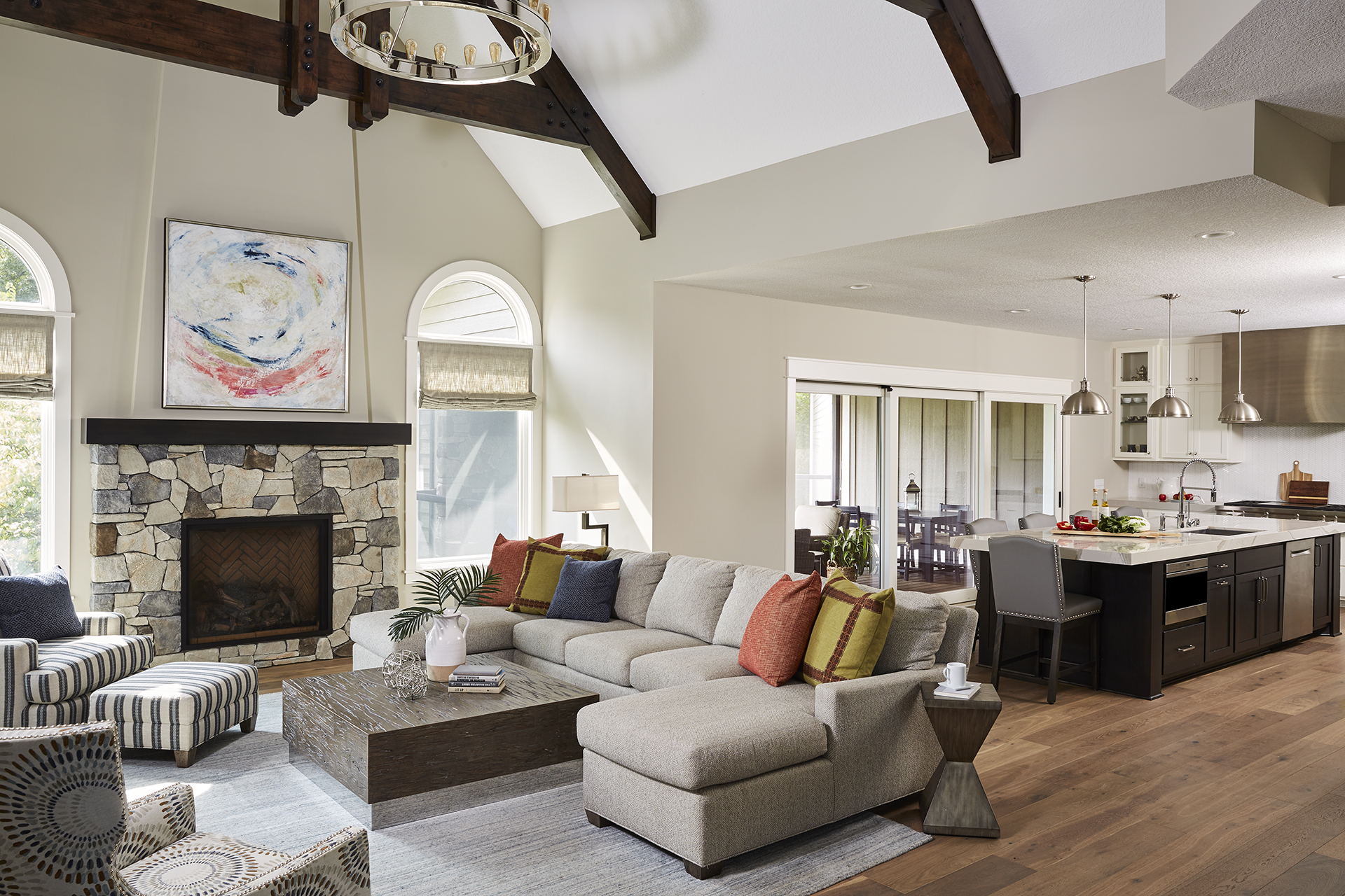 By removing the wall separating the adjoining kitchen and foyer, this living room instantly felt more open and inviting, providing the perfect space for conversation and entertaining.