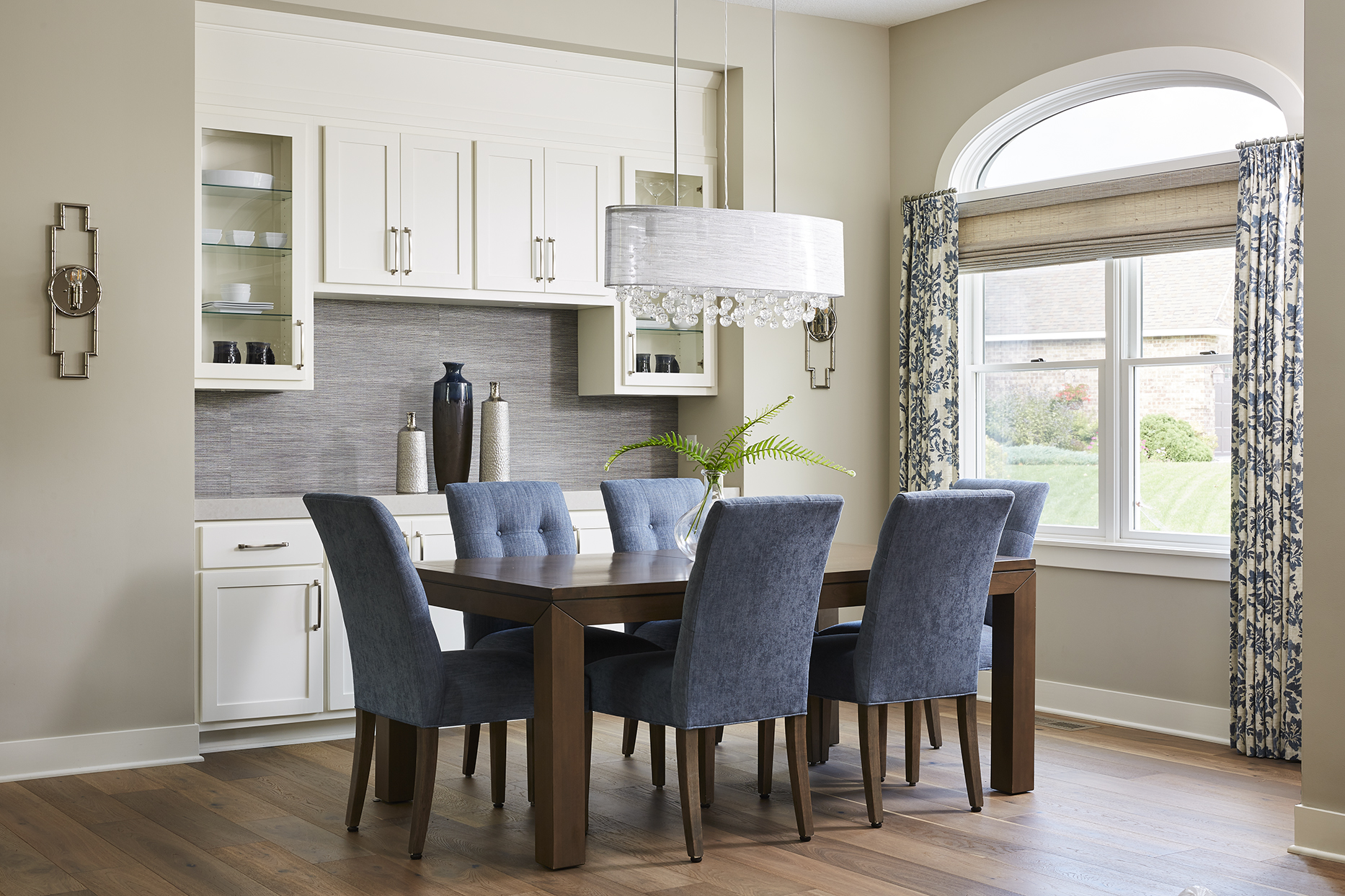 An open and colorful dining space was made possible after removing its original walls, creating a built-in buffet, and installing furniture and fixtures that felt contemporary and chic.