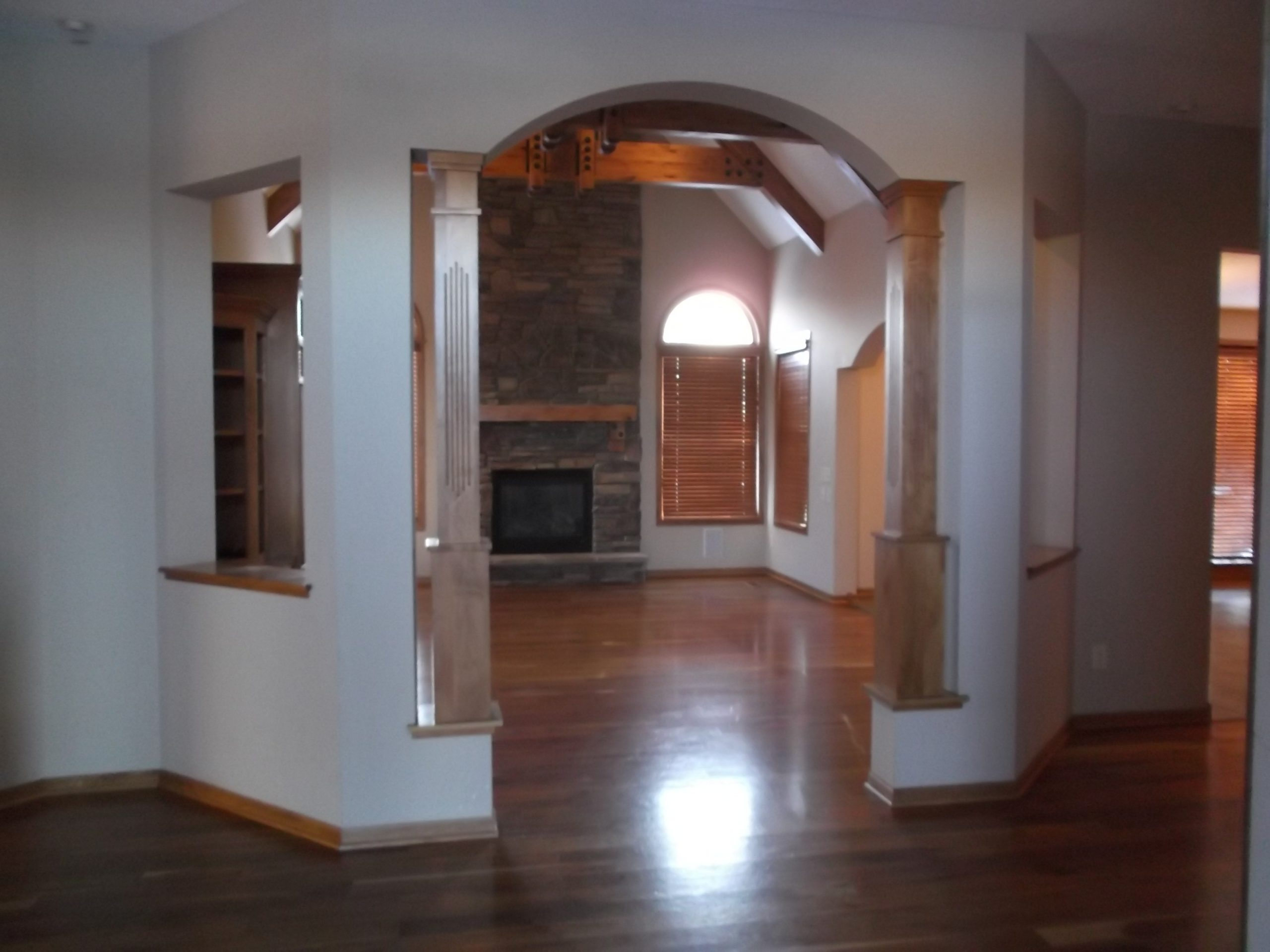 In the original home, the entry to the living room felt cramped and confined, flanked by outdated columns.