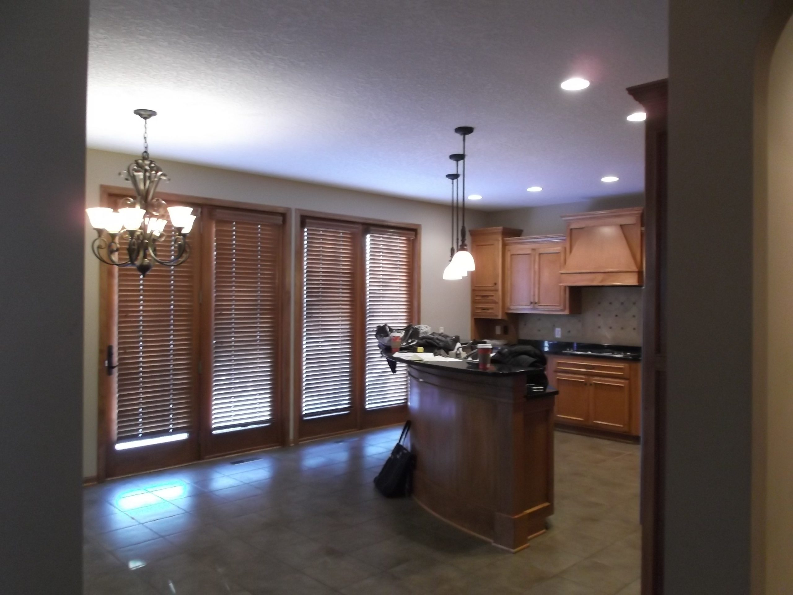 The doors to the existing deck were covered with heavy blinds, closing the space off and blocking the light.