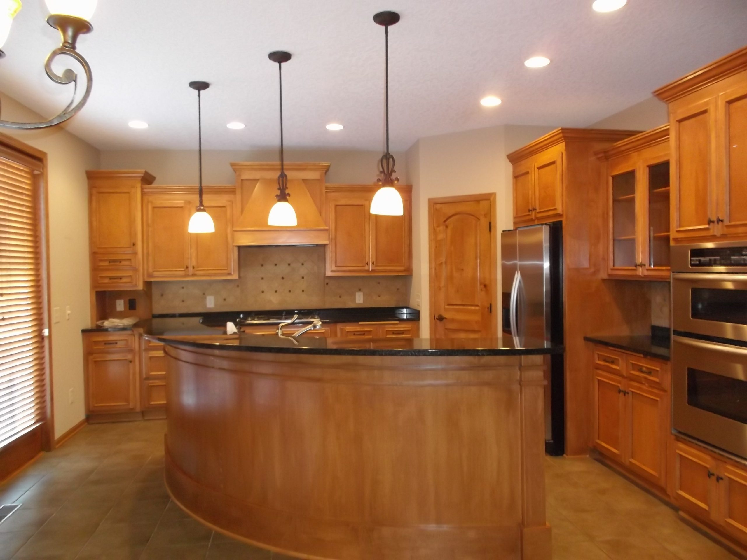 The kitchen initially had an oddly-placed island, which was not functional for our client's needs and had the effect of closing off the space.
